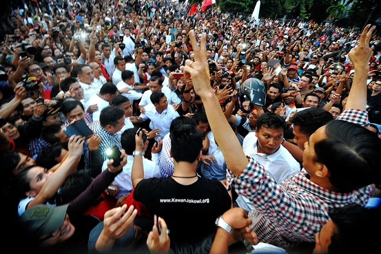 Joko Widodo greets supporters on Wednesday after an early vote count put him in the lead in Indonesia. Zuma Press