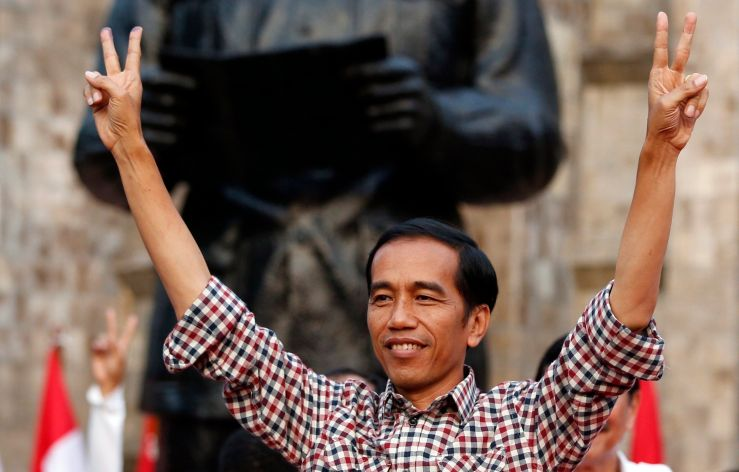 Jokowi gestures during a rally in Proklamasi Monument Park in Jakarta. Image www.themalaysianinsider.com